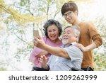 happy elderly with family....   Shutterstock . vector #1209262999