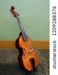 Small photo of Wooden musical instrument Viola de Gamba Wooden violin in instrument stand