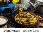 sweet pilaf with nuts and... | Shutterstock . vector #1209297349
