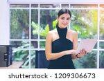 smart business woman using...   Shutterstock . vector #1209306673