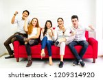 group of friends cheering... | Shutterstock . vector #1209314920