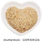 oatmeal in heart shaped plate... | Shutterstock . vector #1209334126
