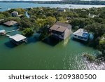 lake side homes now under water ... | Shutterstock . vector #1209380500