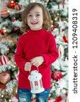 child on christmas | Shutterstock . vector #1209408319