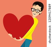 man holds a big red heart in... | Shutterstock .eps vector #1209417889