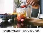 woman preparing healthy juice...   Shutterstock . vector #1209429736
