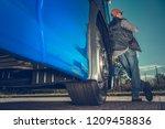 freight industry driver.... | Shutterstock . vector #1209458836