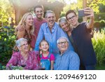in the summer  a family of...   Shutterstock . vector #1209469120