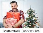 portrait of smiling man holding ...   Shutterstock . vector #1209493126