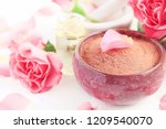 pink clay powder in bowl for... | Shutterstock . vector #1209540070