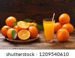 glass of fresh orange juice... | Shutterstock . vector #1209540610