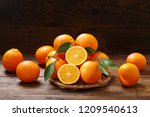 fresh orange fruits with leaves ... | Shutterstock . vector #1209540613