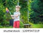 portrait of a happy cute little ... | Shutterstock . vector #1209547219