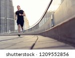 fit athlete running outdoors to ... | Shutterstock . vector #1209552856