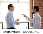 mad male colleagues have... | Shutterstock . vector #1209560713