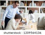 furious businessman shout at... | Shutterstock . vector #1209564136