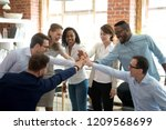 excited multiracial colleagues... | Shutterstock . vector #1209568699