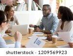 african american employee talk... | Shutterstock . vector #1209569923