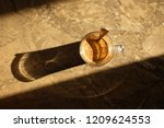 top view steaming cup of coffee ... | Shutterstock . vector #1209624553