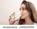 woman drinking water | Shutterstock . vector #1209635590