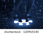 puzzle piece coming down into... | Shutterstock . vector #120965140