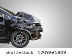 Small photo of Front of black car get damaged by accident on the road. Isolated on white background. Saved with clipping path