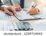 business people meeting... | Shutterstock . vector #1209714043