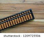 asian analog calculator abacus | Shutterstock . vector #1209725506