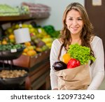 woman grocery shopping at the... | Shutterstock . vector #120973240