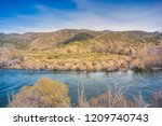 alumine river at neuquen ... | Shutterstock . vector #1209740743
