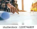 co worker or architect startup... | Shutterstock . vector #1209746809
