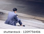 businessman sit on stair use... | Shutterstock . vector #1209756406