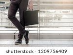 businessman wear black suit... | Shutterstock . vector #1209756409