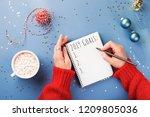 woman's hand writing 2019 goals ... | Shutterstock . vector #1209805036