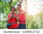 senior asian woman with man or... | Shutterstock . vector #1209812713