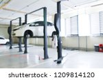blurred car service center  in... | Shutterstock . vector #1209814120