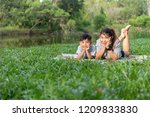 mother and son relaxing in park.... | Shutterstock . vector #1209833830