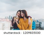 happy asia girl friends enjoy... | Shutterstock . vector #1209835030