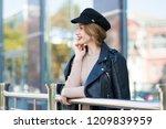 young beautiful woman walks... | Shutterstock . vector #1209839959