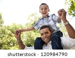 hispanic father and son having... | Shutterstock . vector #120984790