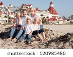 Happy Caucasian Family In Fron...
