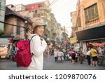 young traveler with backpack at ...   Shutterstock . vector #1209870076