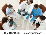 medical staff  discussing the... | Shutterstock . vector #1209870229