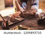 hipster guy with tattooed arm... | Shutterstock . vector #1209893710