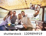 cheerful group of friends...   Shutterstock . vector #1209894919