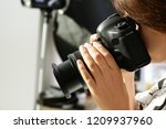 female photographer with... | Shutterstock . vector #1209937960