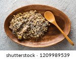 barley porridge with mushrooms... | Shutterstock . vector #1209989539