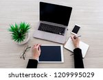 the woman is working with... | Shutterstock . vector #1209995029