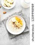 oatmeal porridge with banana...   Shutterstock . vector #1209998989