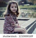 sad crying little girl | Shutterstock . vector #1210000189